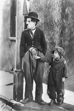 "Charlie Chaplin and Jackie Coogan, ""The Kid"", The Kid is a 1921 silent film written, produced, directed by and starring Charlie Chaplin. This is his first feature film and also a masterpiece. Charlie Chaplin, Vintage Hollywood, Classic Hollywood, The Kid 1921, Charles Spencer Chaplin, Kino Film, Silent Film, Old Movies, Classic Movies"