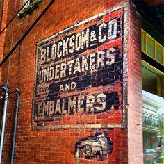 Blocksom & Co. Undertakers and Embalmers Ghost Sign in Eureka Springs, Arkansas