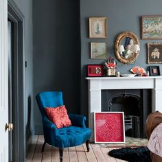 Grey-blue walls with red accents. living room