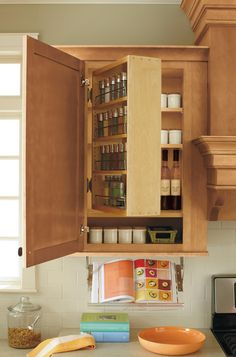 This #MarthaStewartLiving spice rack swings out for easy access and doubles your cabinet storage space. Click for our best kitchen design ideas.