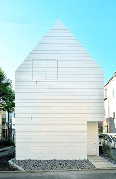 Gabled townhouse in Tokyo by Niji Architects is clad in strips of white steel