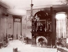 An image of an elegant, high-ceilinged home in Cortland, New York during 1890s. You can tell that it would probably take quite the fire to keep that room warm in winter!