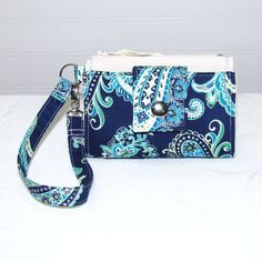 Blue Paisley Cell Phone Wallet Wristlet  Fits iPhone 4, Motorola Droid, Galaxy and similar sized phones. This one has a clear ID sleeve on back so you don't have to open it to show your ID.