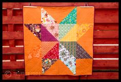 Vibrant Giant Star Quilt by Katy from The Littlest Thistle. Pieced and straight line quilted with Aurifil 50wt #2000.    To see more visit http://thelittlestthistlecraftshop.blogspot.com/2013/01/a-star-is-born.html