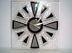 Clock. I could do something like this, as long as drilling the hole didn't crack it!