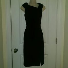 """Black fitted sheath dress Black fitted dress from WHITE HOUSE BLACK MARKET  Size 4  Bust (underarm to underarm): 34.5"""" Waist: 29"""" Hips: 38"""" Length (shoulder to hem): 39""""  With collared neckline. Fitted at waist. Pencil style skirt. 6"""" slit at front left of skirt. With back zip and hook fastening. Belt loops, no belt. Fully lined.   Shell: 72% polyester, 22% rayon, 6% spandex. Lining: 94% polyester, 6% spandex.  In excellent gently used condition. No signs of wear. From a smoke free home…"""