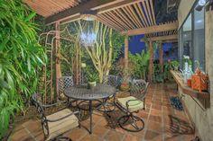 Tropical Patio with exterior tile floors, exterior terracotta tile floors, Trellis, Arbor