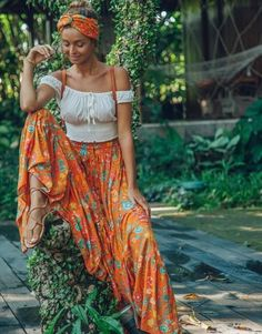 Ulu florence maxi skirt orange blossom Channel your inner bohemian goddess in the Florence Maxi Skirt in lust-worthy colour of the moment, Orange Blossom. This full-bodied skirt i Hippie Chic Fashion, Bohemian Style Clothing, Gypsy Style, Look Fashion, Hippie Clothing, Bohemian Chic Style, Modern Hippie Style, Mode Hippie, Bohemian Mode