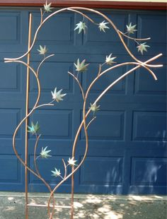 copper trellis - pretty, but the copper thieves would snatch this up in nothing flat!