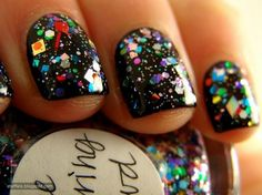 I love the confetti look to these nails. This would be even cuter over a black matte nail polish!