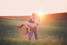 Engagement Ideas boots pose field rolling hills lighting summer Portraits by Andra #engagements