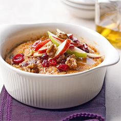 "Creamy Pumpkin Rice Pudding. ♦♦♦♦♦  Tart cranberries, crisp apple slices, crunchy walnuts, and a bit of honey top this luscious, make-ahead fall dessert.  ""Made from Scratch"""