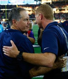 New England Patriots vs. Dallas Cowboys - Photos - October 11, 2015 - ESPN  -  ARLINGTON, TX - OCTOBER 11: Head coach Bill Belichick of the New England Patriots talks with Head coach Jason Garrett of the Dallas Cowboys following the NFL game against the New England Patriots at AT&T Stadium on October 11, 2015 in Arlington, Texas. (Photo by Mike Stone/Getty Images)