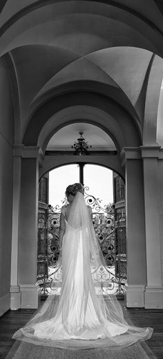 The Bride shows off her beautiful wedding dress in the entrance hall of Braxted Park, Gt Braxted, Essex, www.headoverheelsphotography.co.uk
