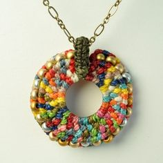 multicolor macrame circle pendant with beads