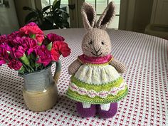 I used the Flowers in a Row stitch for the border of this dress. The stitch pattern can be found here: http://www.knittingstitchpatterns.com/2015/01/flower-in-r.... One cha...