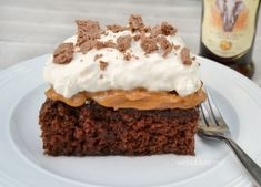 A Chocolate Amarula Cake with layers of moist cake, caramel and whipped cream, topped with flaked chocolate