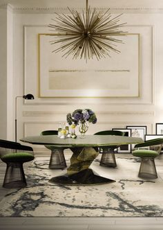 I love the Bonsai shape of the table base and the green fabric on the platner chairs the combo works for me