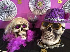 Pimp and Ho party decor. Everything is from the Dollar Tree. Ho: false eyelashes, feather boa, hair headband (and earrings already had). Pimp: silver & gold money chains, purple leopard print hat, gold glittered glasses.