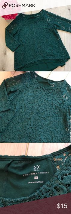 {•High Low Lace Swing Top•} Adorable and in EUC! I just don't wear it enough. Cute with jean or dressed up! Name brand New York & Company. Beautiful hunter green in color. 3/4 length sleeves. Open V in the back. Under lining is a soft jersey knit material. Sleeves are sheer. Size M. Bust 40 inches waist 41 inches. From a clean and smoke free home! Bundle to save on shipping or for a private discount  {• Poshmark Ambassador {•300+ Sales {•Party Host {•Same/Next day shipping New York & Company…
