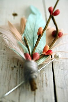 CONFETTI Boutonniere by Pomp And Plumage on Etsy | We love the way this boutonniere just sings springtime. Handmade from perfectly hand-dyed champagne pink, ivory and duck-egg blue feathers, pops of pink-berried millinery branches, and a wrap of super soft, nebulous light grey wool. Perfect for vintage-inspired and woodland fetes.