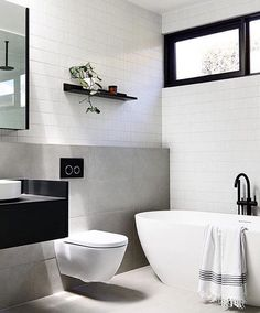 One of our popular tiles InaxJapan Yohen Border as feature walls in the Blairgowrie House bathroom By studiotomdesign plannedlivingarchitects natjstyling Build madebuild Images derek_swalwell moderndesignbathrooms Bathroom Windows, Bathroom Renos, Laundry In Bathroom, Bathroom Shelves, White Bathroom, Bathroom Faucets, Small Bathroom, Master Bathroom, Bathroom Ideas