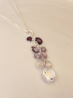 sale SHADES of PURPLE multi spinel heart drops with rock crystal quartz focal briolette pendant. $40.00, via Etsy.