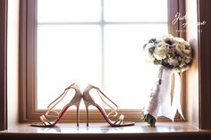 wedding photographer in maryland judah avenue photography took this photo of a  a wedding bouquet and shoes at the wedding at the george peabody library in baltimore maryland. We are wedding photographer in washington dc, maryland and virginia. we specialize in wedding photography  and are the premier wedding photographers in washington dc, maryland and virginia