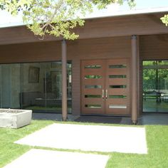 """Love the front entrance of this contemporary home...from the glass inserts in the door to the full wall glass panels is the perfect design to make a """"grand entrance""""!   www.franksglass.com"""