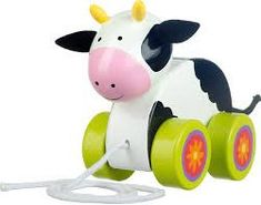 A delightful traditional wooden which will encourage your child to walk and pull along the happy cow. This high quality toy is hand painted and comes in an attractive gift box. Features Traditional wooden toy Painted by hand Durable Attractive gift Cord t Cow Toys, Farm Toys, Pull Along Toys, Happy Cow, Black Cow, Cute Cows, Pull Toy, Farm Yard, Retro Toys