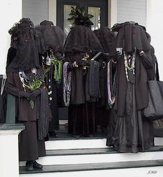 The Merry Widows of Joe Cain, awaiting their annual trip to his grave, in Mobil AL at Mardi Gras.