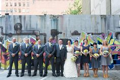 yellow and grey wedding party in front of graffiti, JayLee Photography