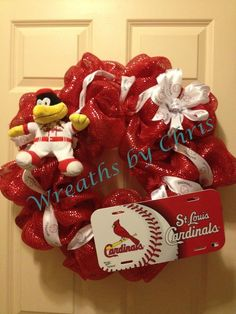 A World Series Champion STL Cardinals wreath!  Red wide foil deco mesh is the base for the license plate, FredBird and a baseball ribbon and bow top that off the wreath!  Go Cards!