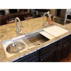 Undermounted sinks with a ledge that allow for accessories to slide and create many functional applications.