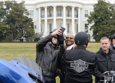 Harley-Davidson officials take photos as they await President Donald Trump for talks with company officials and nationwide union leaders on…