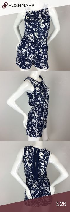 Sleeveless Floral Romper by HYPR, Small Sleeveless white and blue floral rompers with buttons up the back. Size: Small HYPR Other