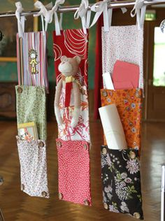Hanging storage for little items. Each bag can be buttoned to the next for more storage.