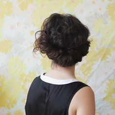 13. Tuck + Roll: All you need to create this easy updo is an elastic headband. Place it over your hair, and, like the name implies, just tuck and roll your hair. Easy peasy! It's perfect for those busy mornings. (via Delightfully Tacky)