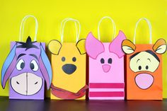 """Decorate your Winnie the Pooh Party with these cute faces on your Favor Bags. You may print as many as you need. Use them to create your own favor bags or centerpieces. This PDF file includes: 2 Winnie the Pooh 1 Piglet 2 Tigger 1 Eeyore Instruction Sheet (Bags are not included)  Instructions: 1) Purchase the file 2) Download the file: Click """"You"""" then click """"Purchases and Reviews"""" then download 3) Print the File (On White Card stock paper) 4) Cut the Image 5) Paste on the bag (I Recommend 5…"""