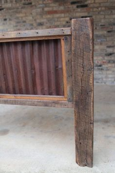 Rustic Headboards a rustic bed frame with rusted corrugated tin as the inset