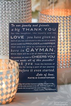 """Anna and Spencer Photography, Atlanta Wedding Photographers. """"Thank You"""" note from the bride and groom to their guests at a wedding reception on Grand Cayman Island. White lettering on navy background."""