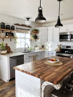 Farmhouse Style Lighting For Your Home butcher block counters white kitchen boho Farmhouse spring ki Modern Farmhouse Kitchens, Farmhouse Kitchen Decor, Kitchen Redo, Kitchen Interior, New Kitchen, Home Kitchens, Kitchen Dining, Kitchen White, Decor For Kitchen Counters