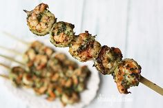 Grilled Pesto Shrimp Skewers | Skinnytaste - 4.5 stars - so good and really easy, plus they're healthy!  We forgot to marinade it for a few hours ahead of time and it was still delish. We had it with a side salad, but next time we might make it a little unhealthier and serve it over pasta (reserving ~2T of the pesto before marinating).