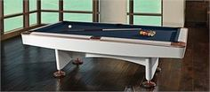 What do you get when you take the performance features of our world-class Gold Crown IV billiard table and combine them with a sleek, contemporary finish? The Limited-Edition White Gold Crown IV, the only Brunswick table ever created with white laminate f Brunswick Pool Tables, Brunswick Billiards, Pool Table Accessories, Billiard Lights, Air Hockey, White Laminate, Pool Cues, Gold Crown, Living Room Inspiration