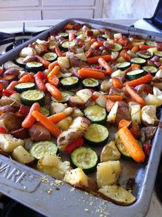 Beautifully roasted vegetables! : red potatoes, russet potatoes, zucchini, red bell pepper, baby carrots, sweet potatoes, and whole garlic cloves dusted with parmesan for the last 10 minutes in the oven. Y~U~M
