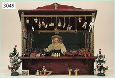 German Christmas Stall, ca. 1920's. 41 cm high x  63 cm wide  Handmade with musical mechanism inside.
