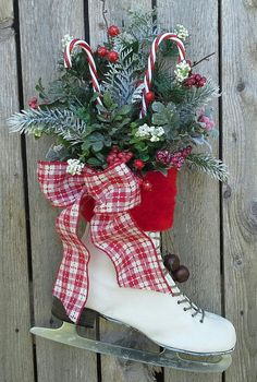 Christmas decor, Decorated Ice Skate, Christmas Ice skate , Wreath, Wall decor, Country Door decor Easy idea! Buy used skates or use some that are hanging around the house, and then decorate them with Christmas bows for a unique decoration. For more ideas connect with us on Pinterest or visit www.myuglychristmassweater.com!