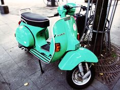 Bright Vintage Vespa Scooter and I WOULD TAKE THIS IN A HEARTBEAT...color and all right now :)