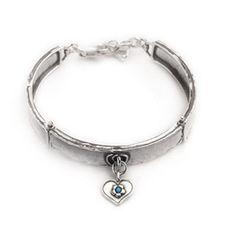A fabulous designer bracelet with heart charm. http://www.oghamjewellery.com/Sterling-Silver-Heart-Bracelet-ASB187-p/asb187.htm