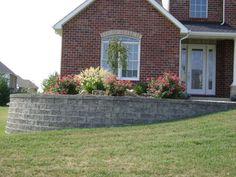 A Retaining Wall Is Used On This Project To Level The